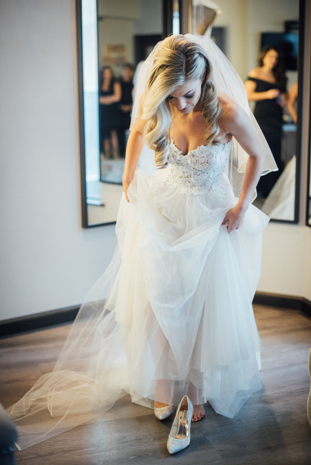 Bride Putting Dress On.jpg