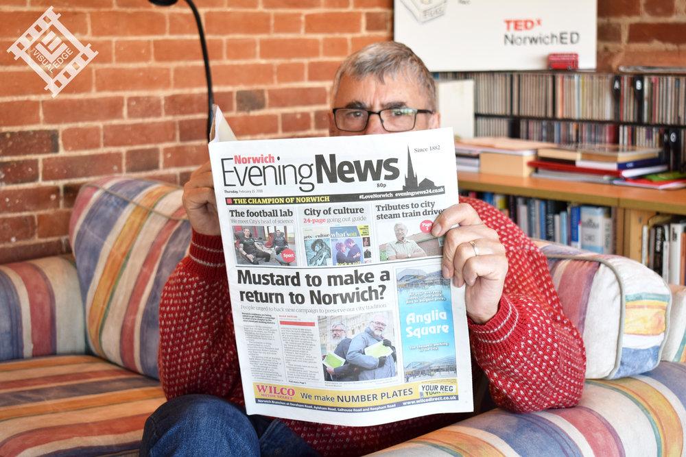 Robert With Paper 2.jpg