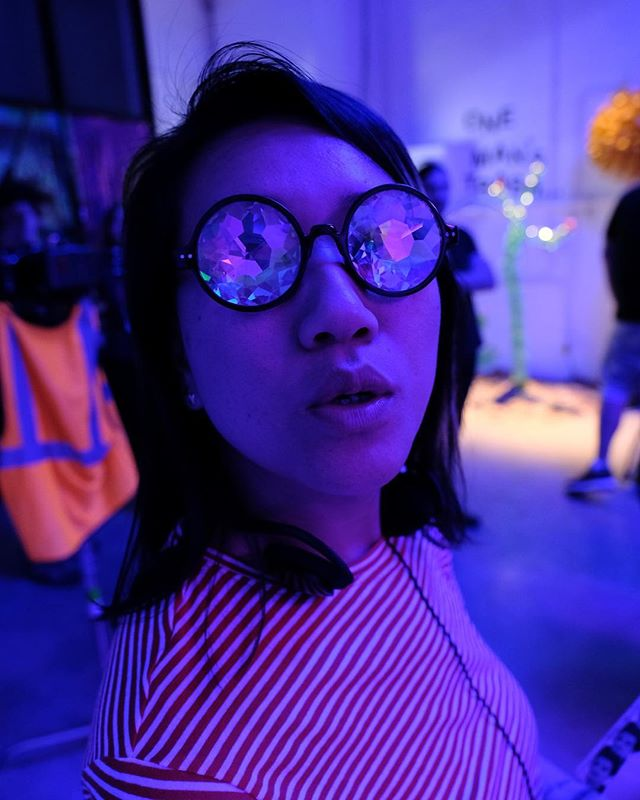 20/20. The future is lookin' real spectacular. Thank you @franceslynnie for this scavenger hunt gem 🤓 📷: @lexy.beast #femalefilmmakerfriday #spectacles #portrait #BTS #onset #producerlife #neonlights #TGIF #nofilter