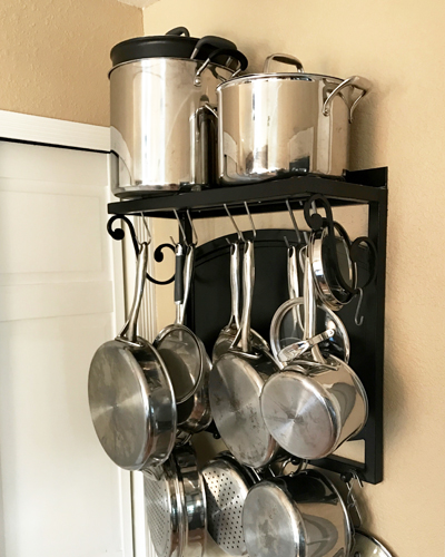 9 Ways to Find Extra Storage in a Small Kitchen | kitchen organization | pot rack | repurposed pot rack | reclaimed potrack | pot rack on the wall | Urban Cottage Living