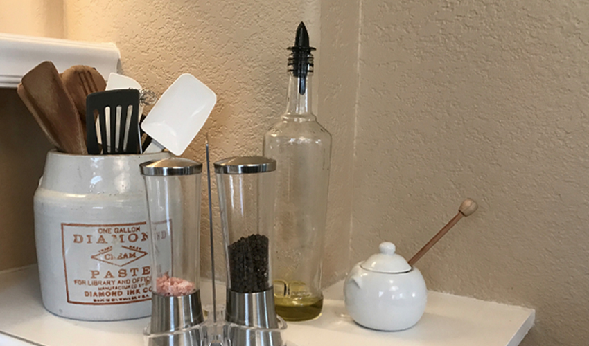 9 Ways to Find Extra Storage in a Small Kitchen | kitchen organization | spatula holder | wooden spoon holder | oil bottle | salt and pepper grinder | Pampered Chef | Urban Cottage Living