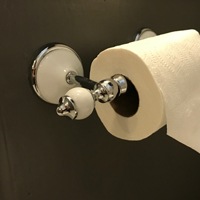 Love this toilet paper holder. It's so classic and great for this 1930's bathroom reno on a budget.
