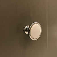 Classic chrome and white drawer knob. Looks perfect in the sweet little bathroom that was done on a budget.