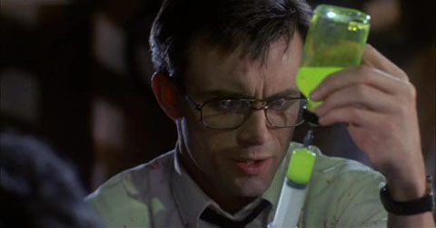 Herbert West (Jeffrey Combs) prepares a dose of his re-animating agent.