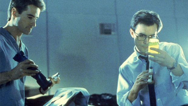 Herbert West (Jeffrey Combs) and Dan Cain (Bruce Abbott) prepare to experiment on their first human test subject.