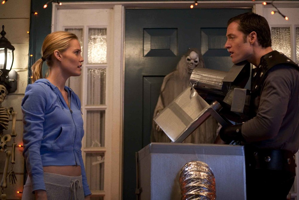 Emma (Leslie Bibbs) and Henry (Tahmoh Penniket) argue over Halloween decorations.