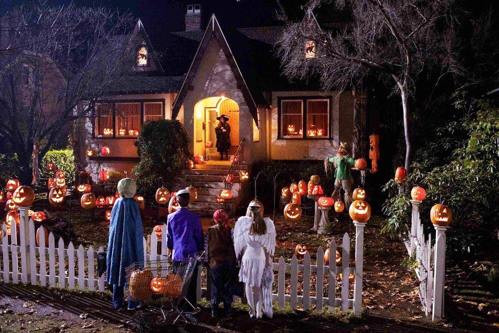 The kids greet Rhonda outside her house.