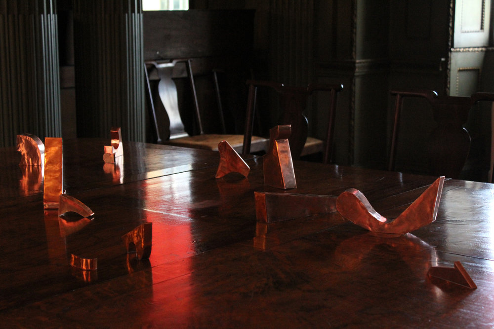 conversation piece  copper on dining table, dimensions variable