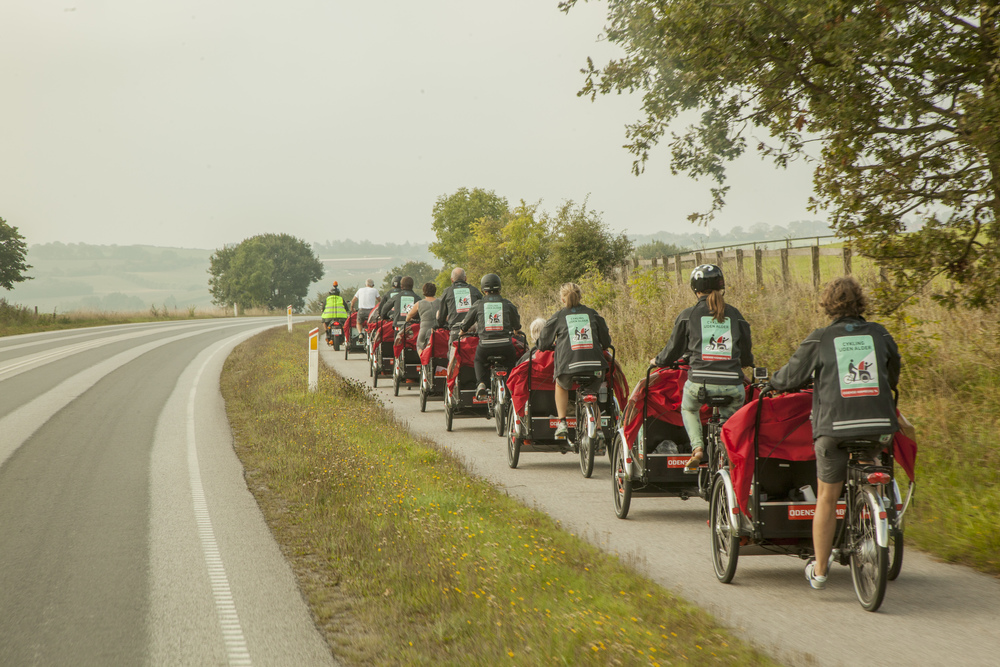A train of rickshaws on the move.