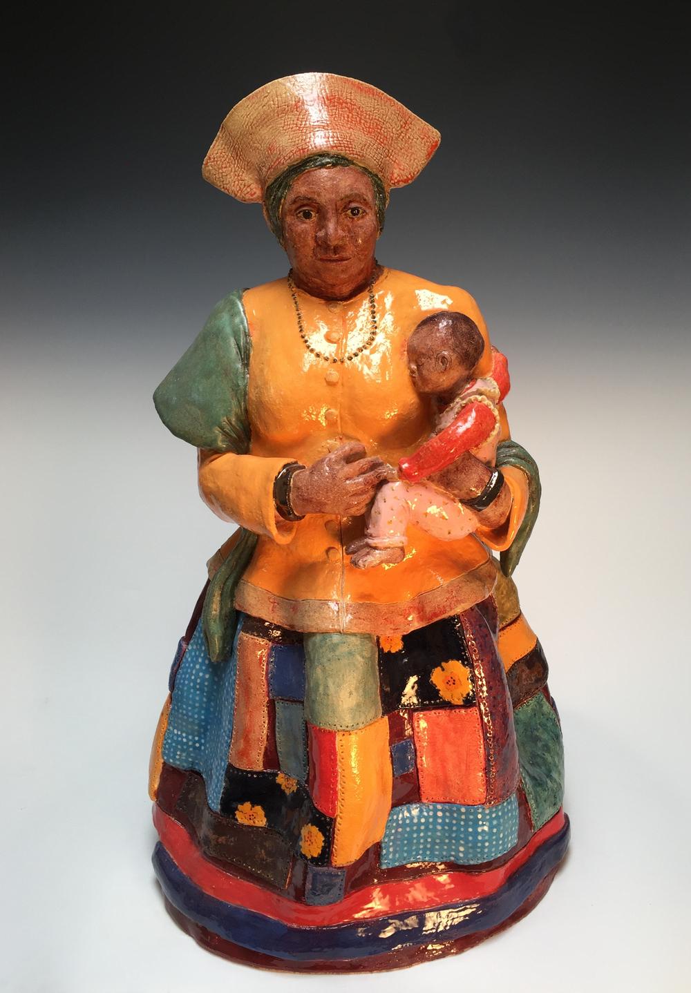 Herero woman with child