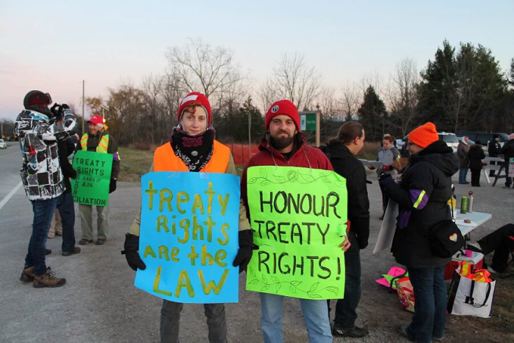 Christian Peacemaker Team members take part in a counter-protest in defense of Haudenosaunee hunting rights at Short Hills Provincial Park.