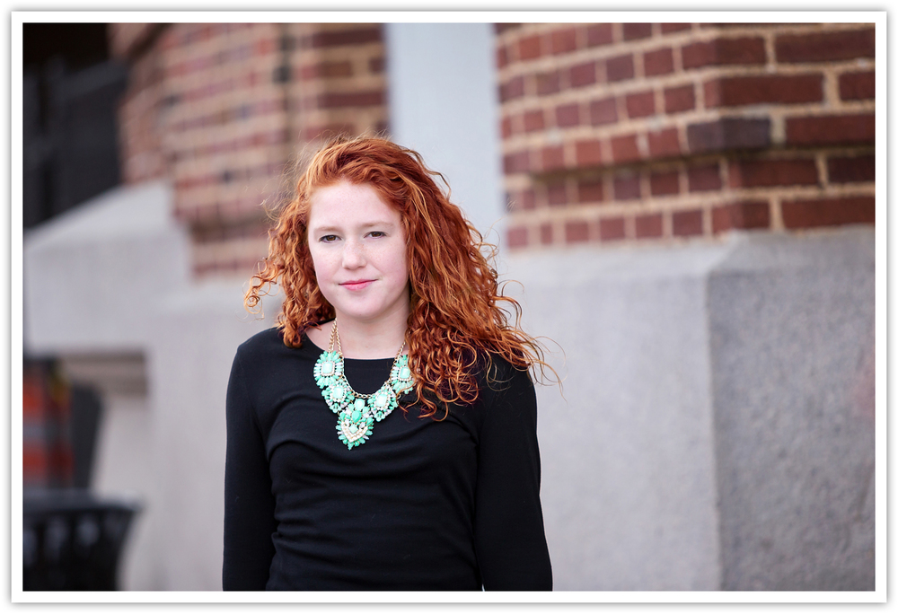 Red head tween with green necklace