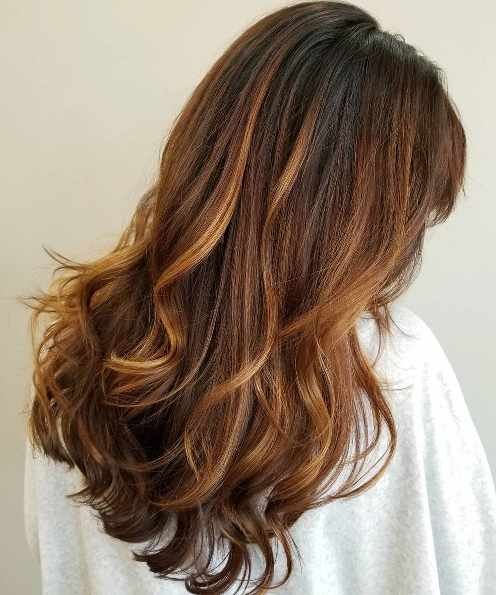 For the Brunettes - Enhance your color by adding a soft golden balayage to your color routine. It is a great choice for the season!  Whether it's a partial or full highlight, you won't be disappointed with the added dimension and shine.