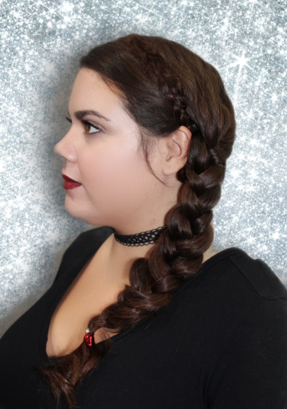 Low Side Braid - Pull the hair to the side of the head and separate into two sections. Braid both of the sections, pulling lightly on the outer sides of each braided piece to make the braid look puffy and full. If you are feeling like you want a challenge, make a small braid and include it like a headband/halo.