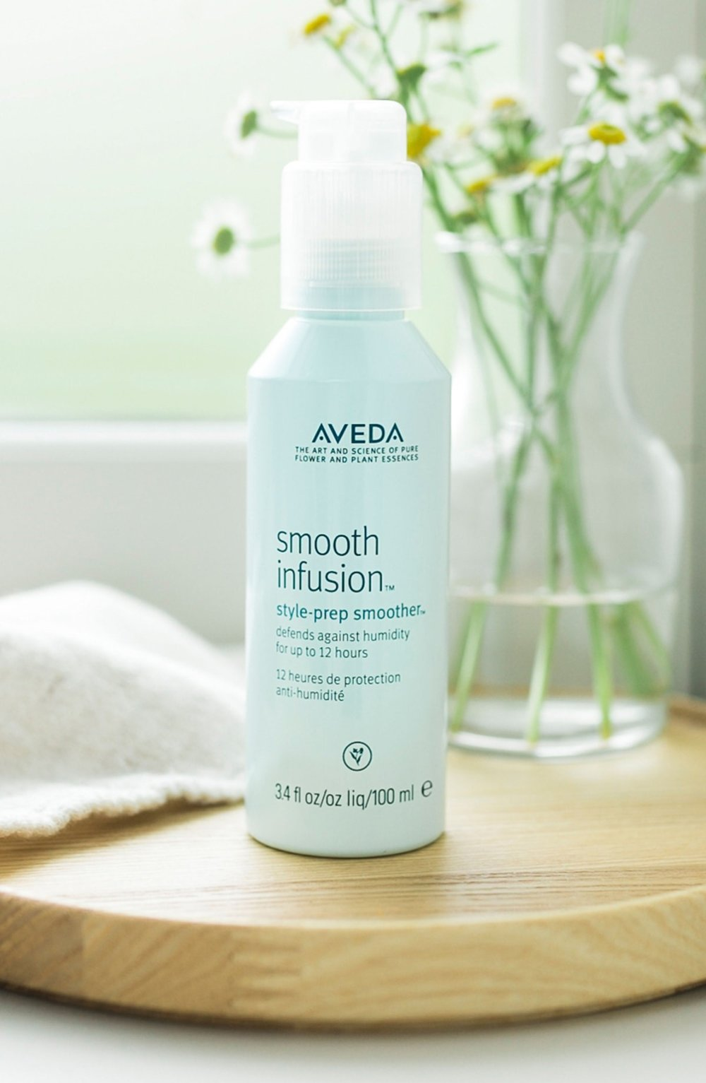 Smooth Infusion Style Prep Smoother - This is an essential that stylists and guests adore for kicking the Florida-frizz. With one pump, not only do you have a 12 hour humidity defense, it also helps protect from heat styling!