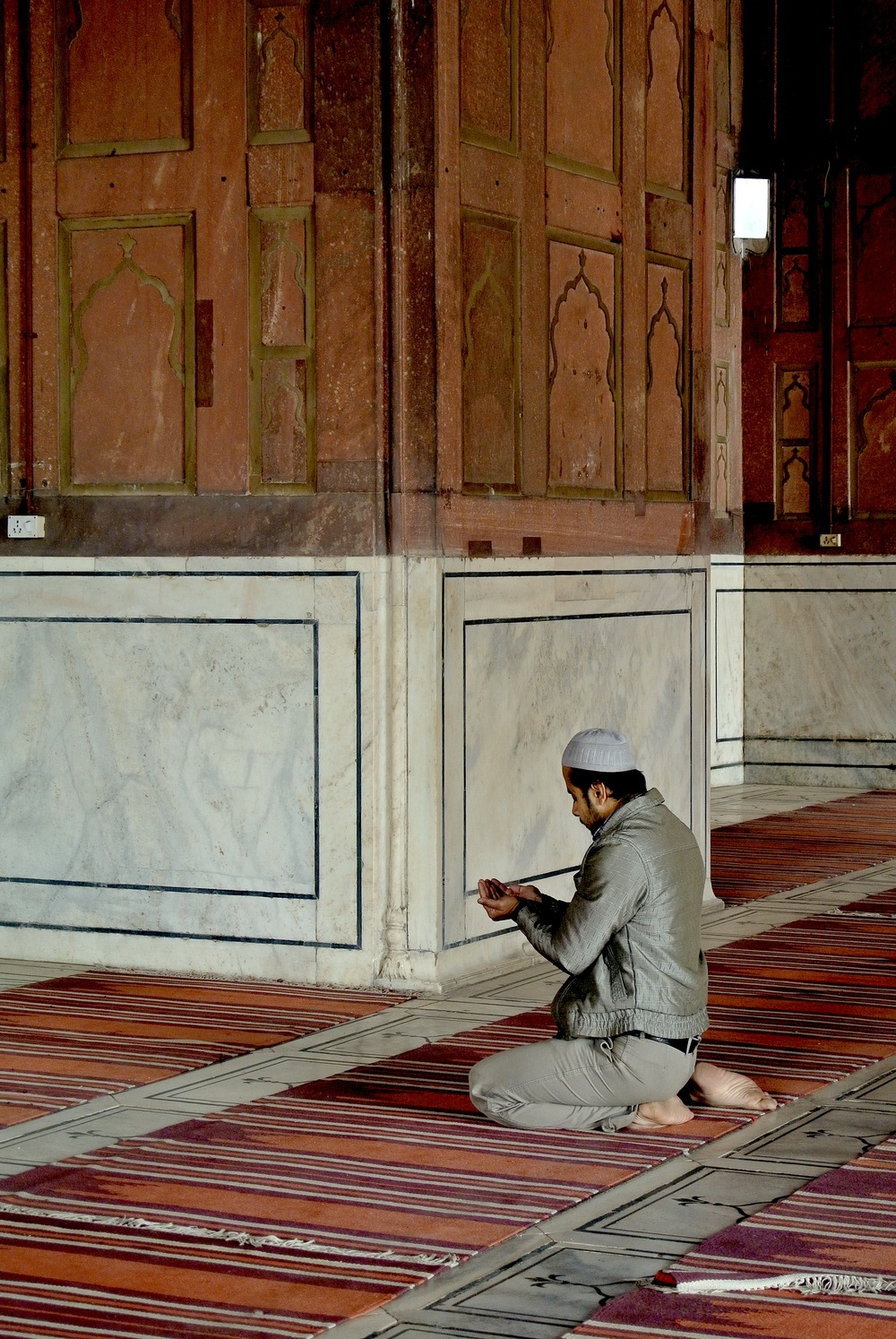 A Muslim prays on one of the many mats in Delhi's Jama Masjid mosque