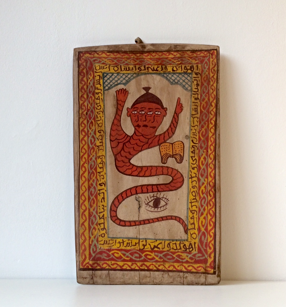 We bought this Quranic teaching tablet depicting what we imagine is a djinni from Ensemble Artisinal, an artists' co-op, in Marrakesh for about $35