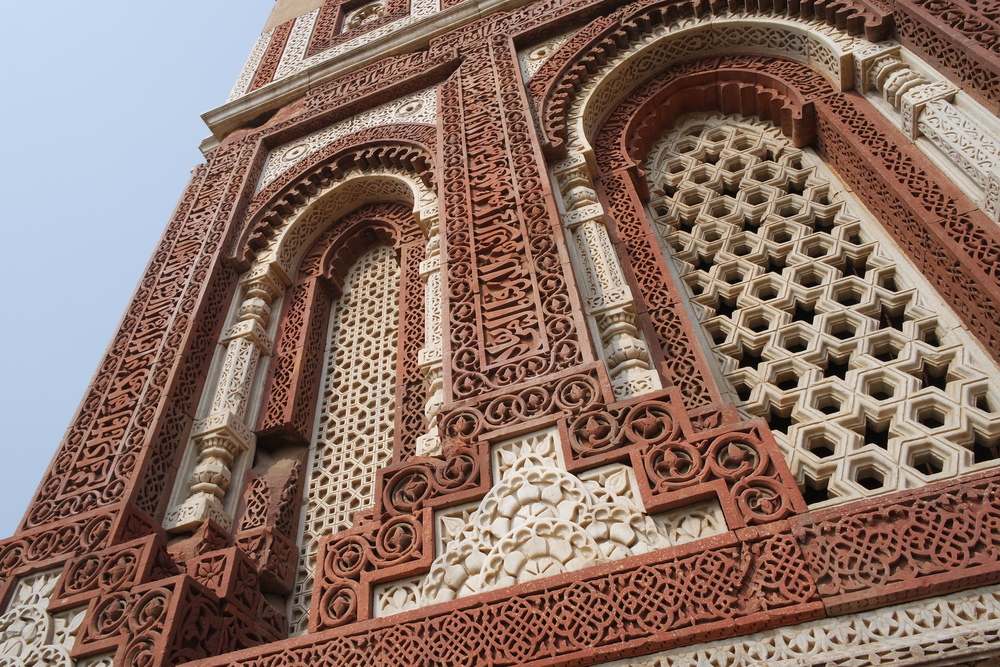 The red sandstone and white marble façade of the Alai Darwaza Mosque in the Qutb Minar complex
