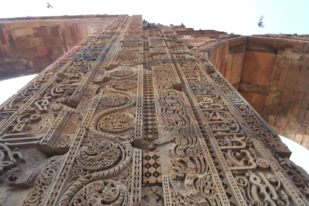 Elaborate pillars stolen from other religions' temples now decorate the Quwwat-ul-Islam Mosque
