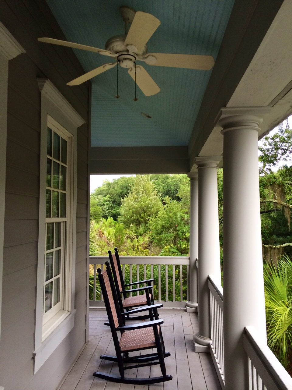 My parents painted the ceiling of their front porch haint blue, a tradition in the Lowcountry