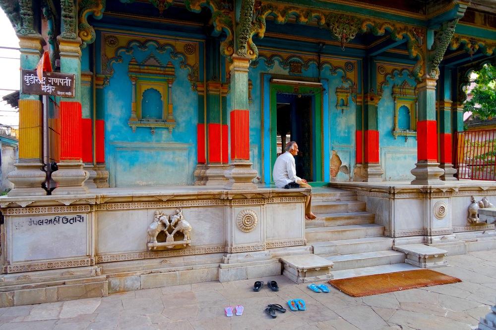 Visitors leave their shoes outside the Dhundiraj Ganpati Mandir temple in Baroda, India