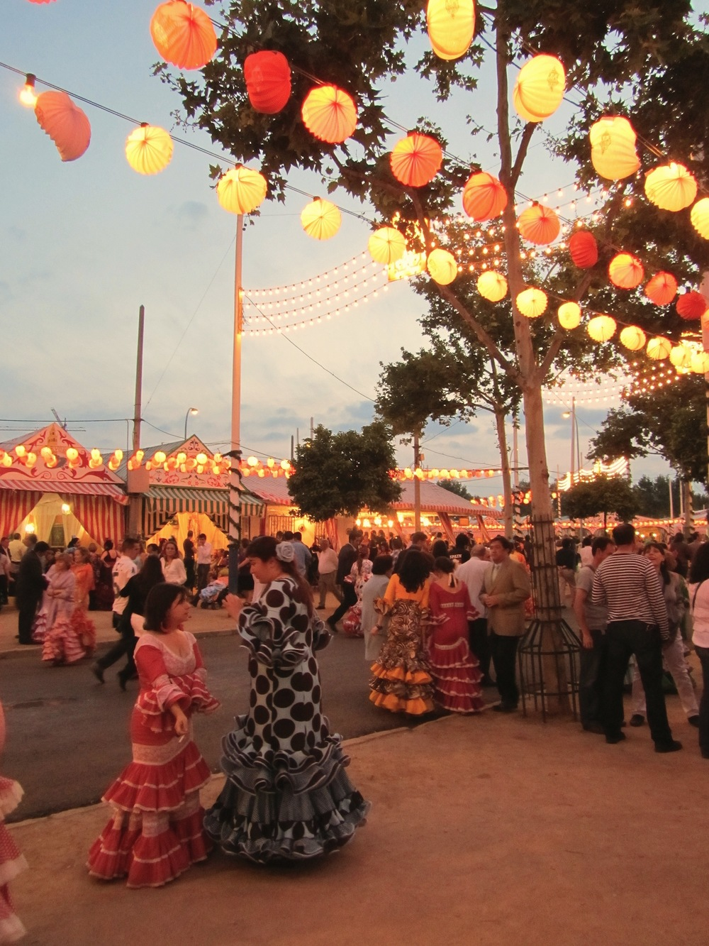 The fairgrounds in Sevilla, Spain during Feria are filled with women in flamenco dresses