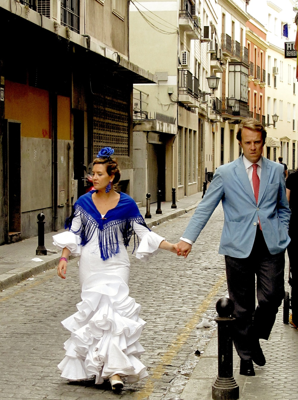 Couples all dolled up for Feria walk the streets of Sevilla