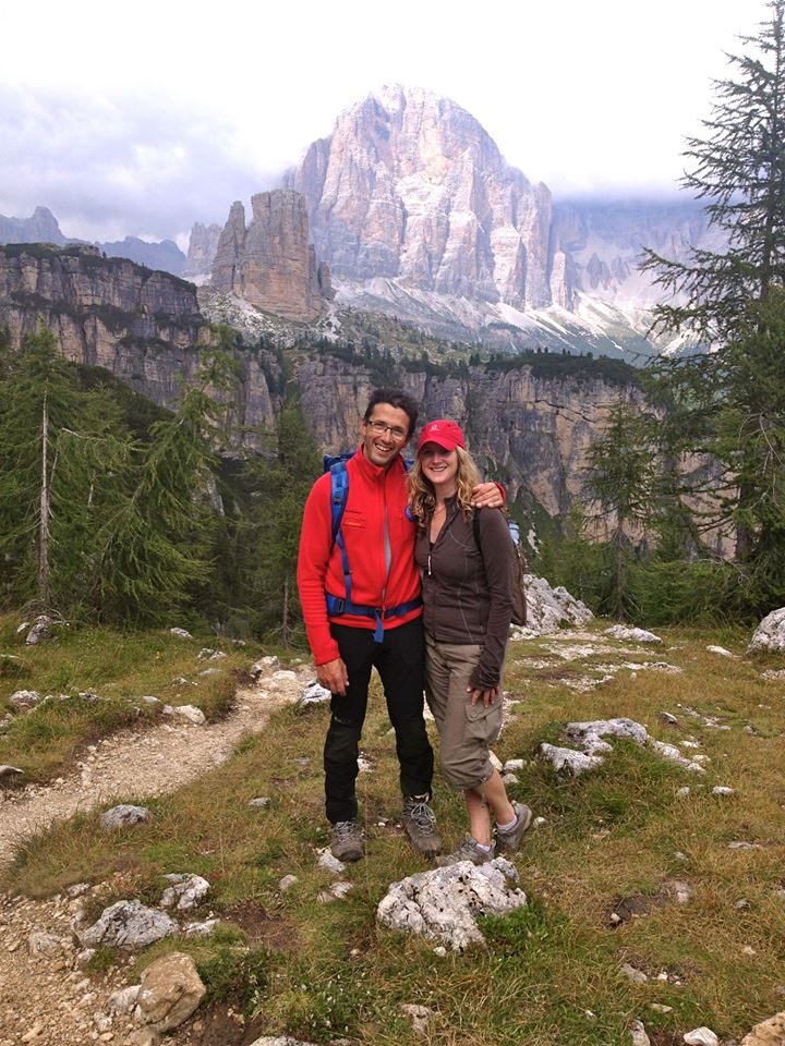 Nancy and her local guide, with the Cinque Torri in the Dolomites as a backdrop