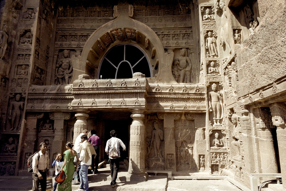 Cave 19: On either side of the arched window are nature spirits called yakshas