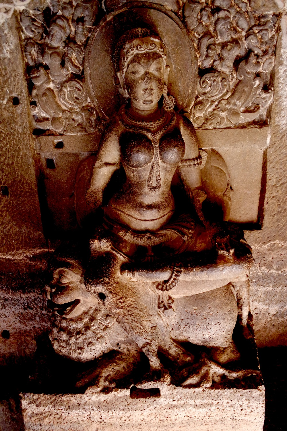 This statue in Cave 32 depicts either Ambika, the Jain mother goddess, or Siddhayika, a yakshini, or fairy-like creature. She's seated upon a lion beneath a tree heavy with fruit