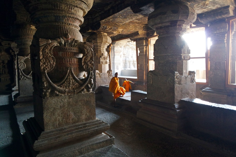 Monks in bright saffron robes can be seen throughout the Ellora complex, including the stunning second story of Cave 32