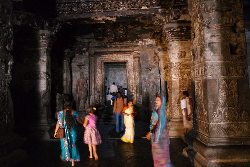 Inside the Hindu temple, visitors bustled around, but it was almost eerily quiet