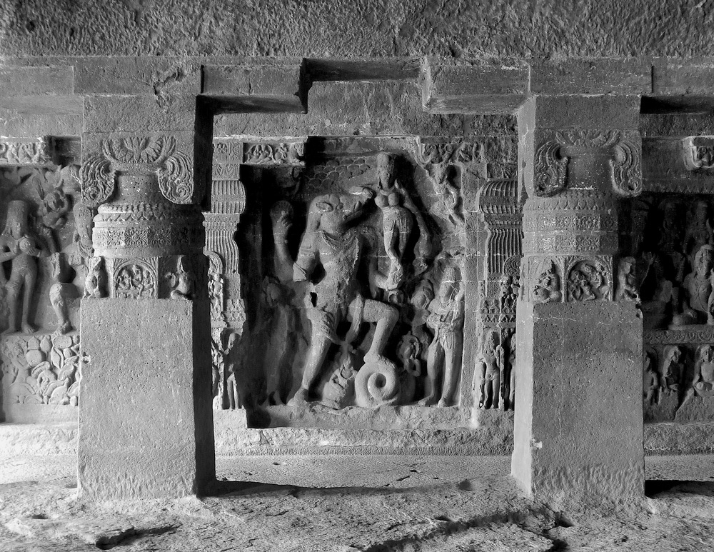 In the center of this carving in Cave 14, Varaha, the boar-headed avatar of Vishnu, rescues the Earth goddess by holding back the engulfing ocean