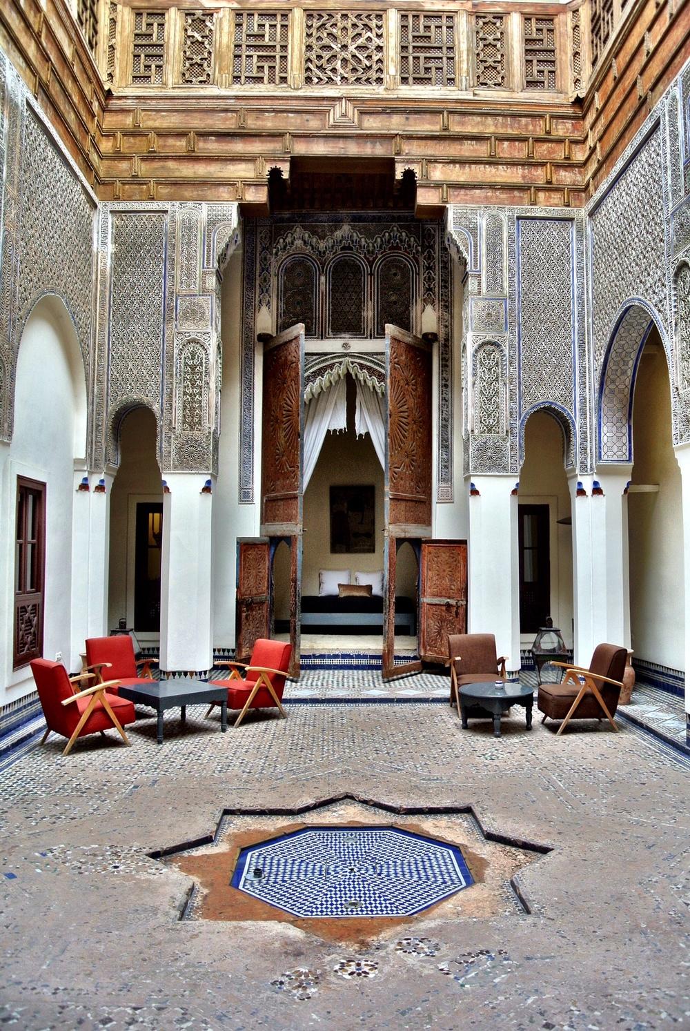 The stunning interior courtyard of Riad Dar Bensouda in Fès, Morocco