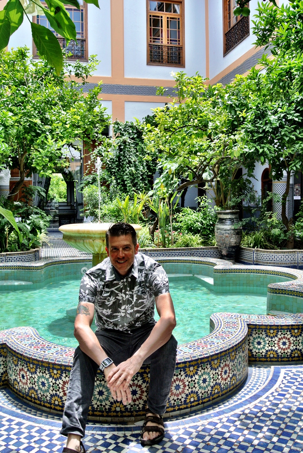 Wally enjoying the beautifully tiled courtyard fountain