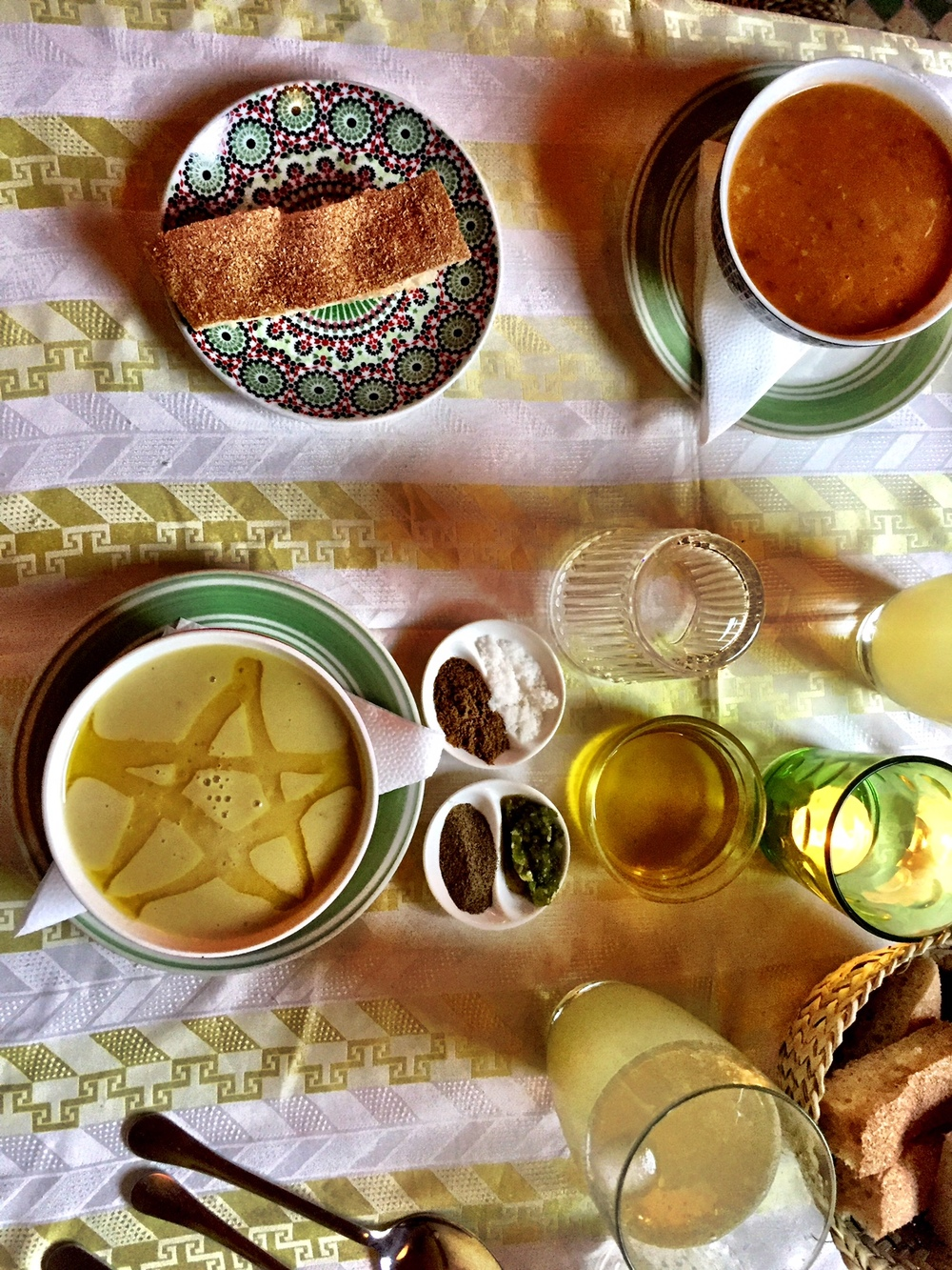 We started with a soup course: harira for Duke and bessara, a fava bean soup with a Moroccan star in oil, for Wally