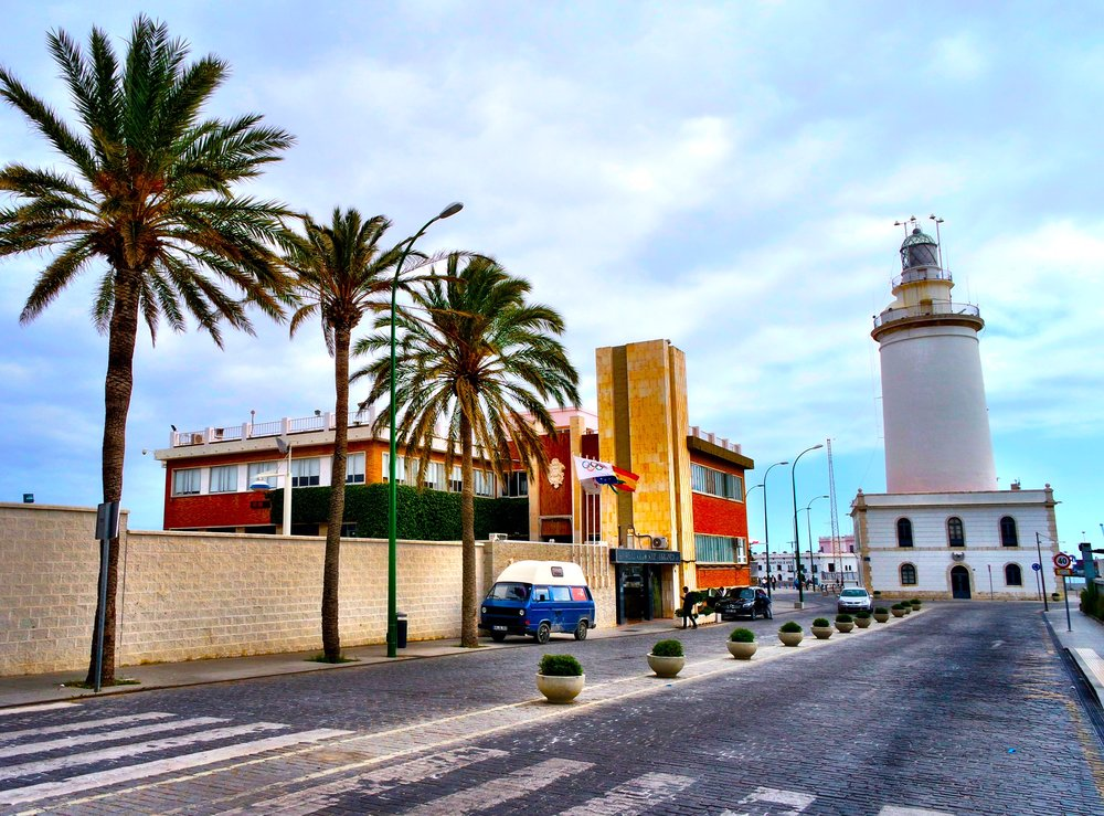 The Málaga Lighthouse sits on the harbor of this modern city with ancient origins