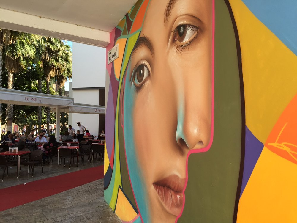 A Picasso-inspired mural at the entrance to El Pimpi, a popular Málaga restaurant