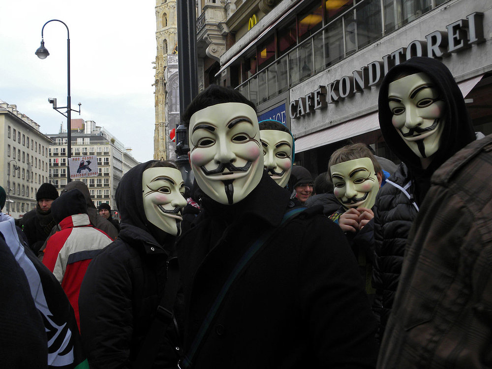 Guy Fawkes masks have swept the world, as seen in this group in Vienna, Austria