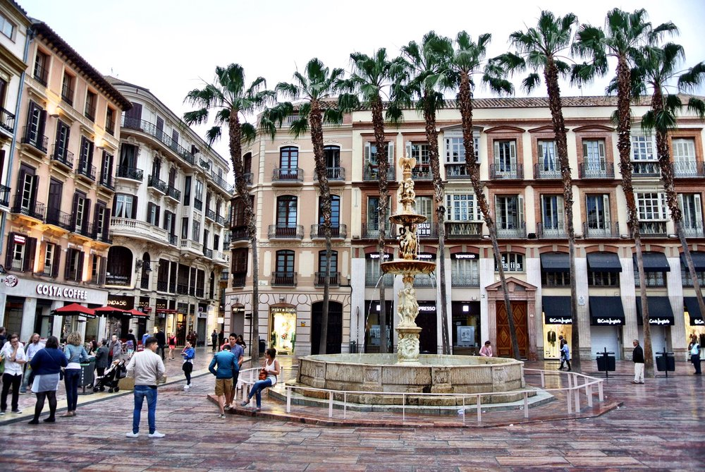 Enjoy a customized cup of coffee and people-watch at Café Central's sidewalk seating, situated on the beautiful Plaza de la Constitución in Málaga