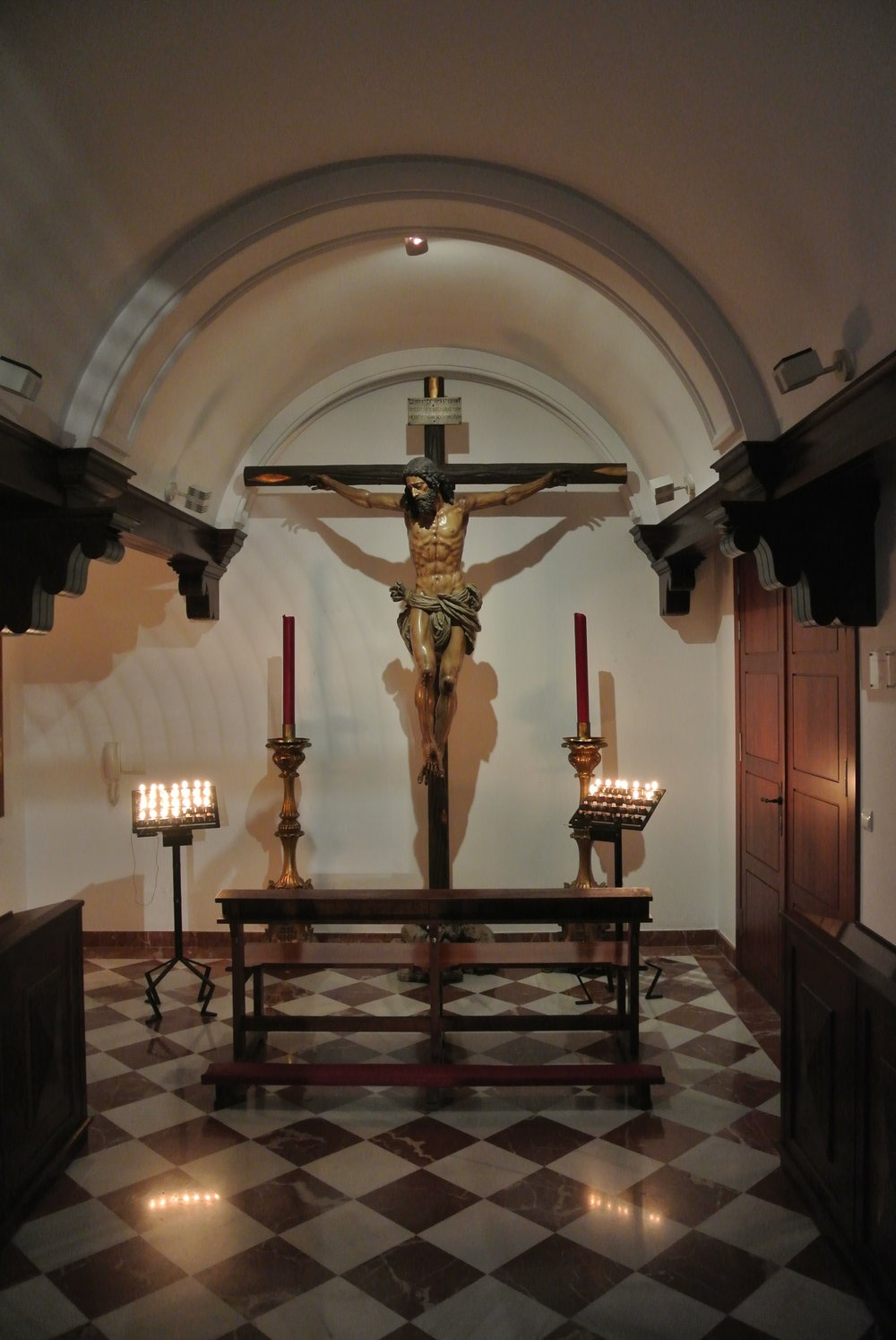 Off to the right of the sanctuary is a small candlelit nave