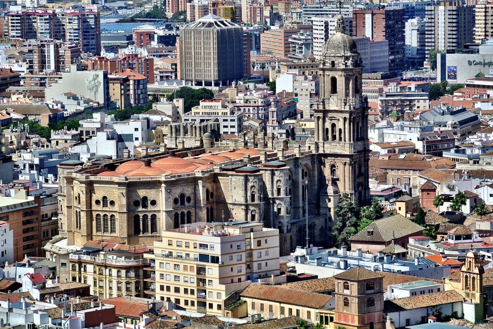 The Málaga Cathedral stands proud as the buildings of the city center encroach upon it