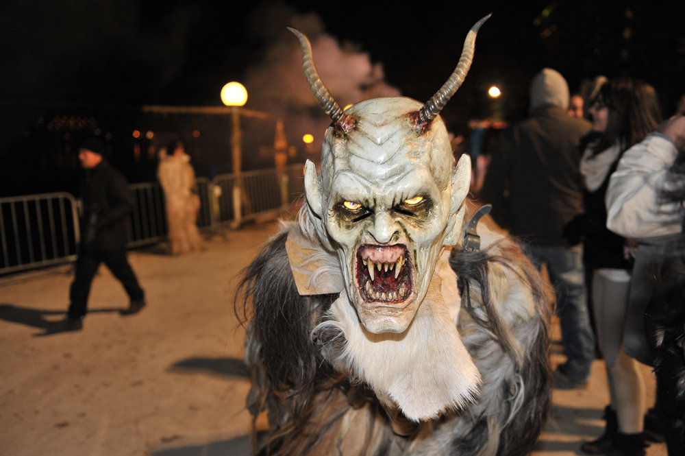 A man dressed in his horrific finery takes part in a Krampuslauf, or Krampus Run