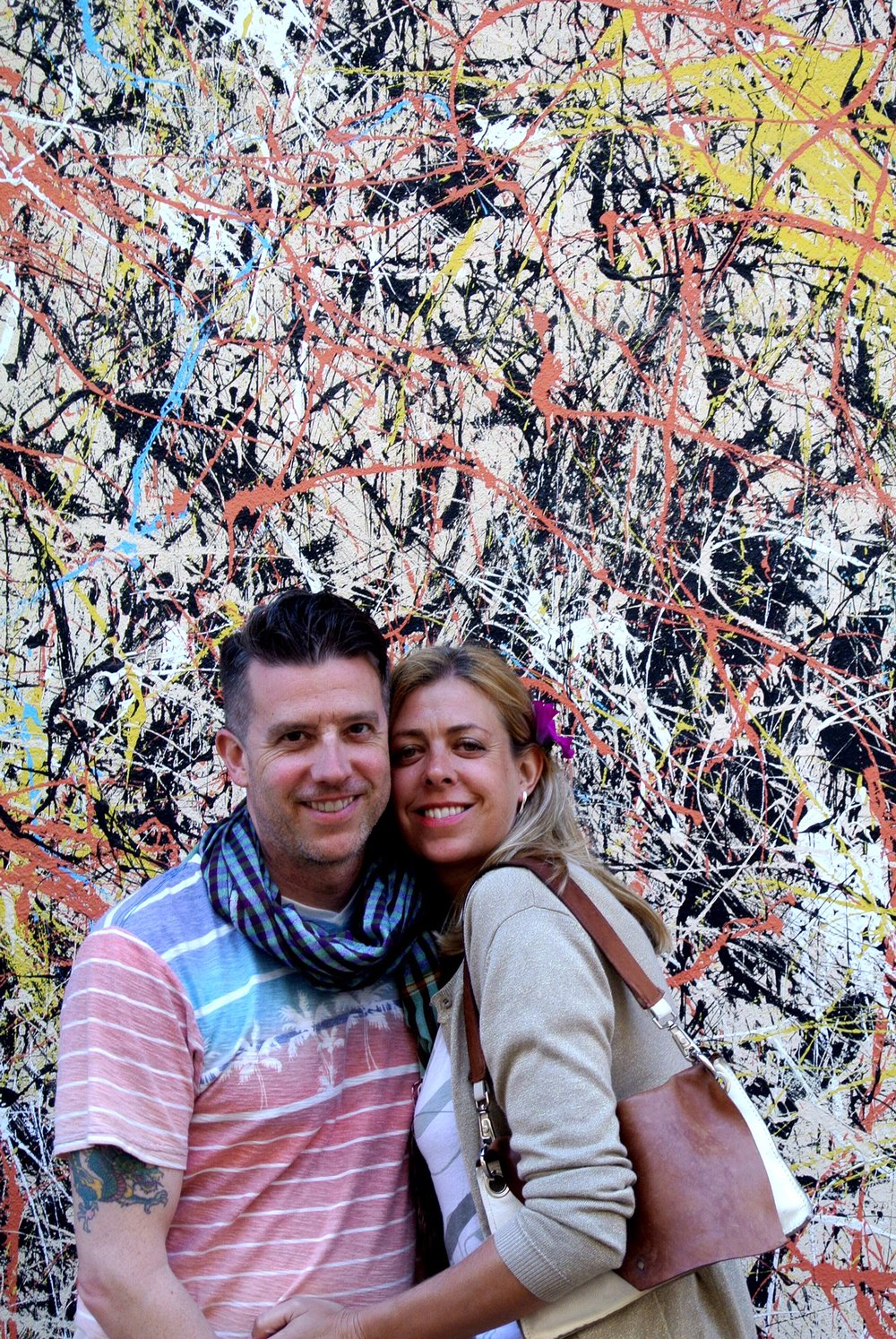 Wally and Jo pose in front of street art