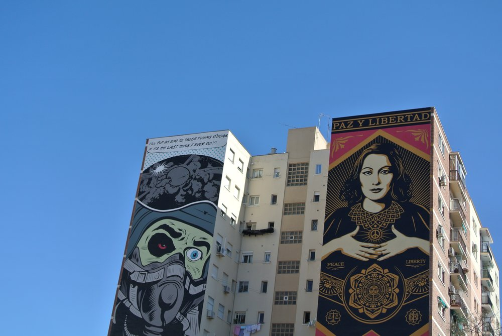 Vibrant murals by D*Face and Obey loom above the art museum