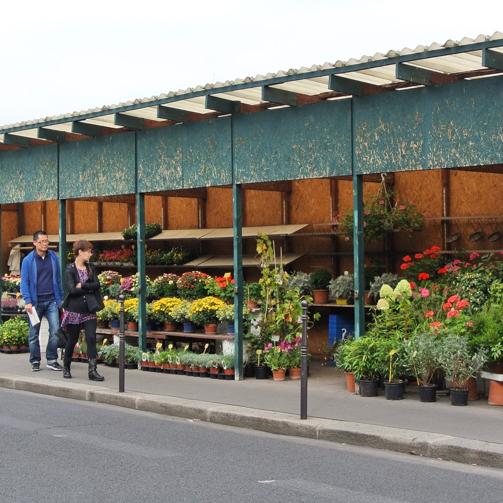 6. Both covered and open-air, the green metal pavilions from the 1900s form the charming flower market located on Place Louis Lépine in Paris, between the Notre Dame Cathedral and Sainte Chapelle chapel.