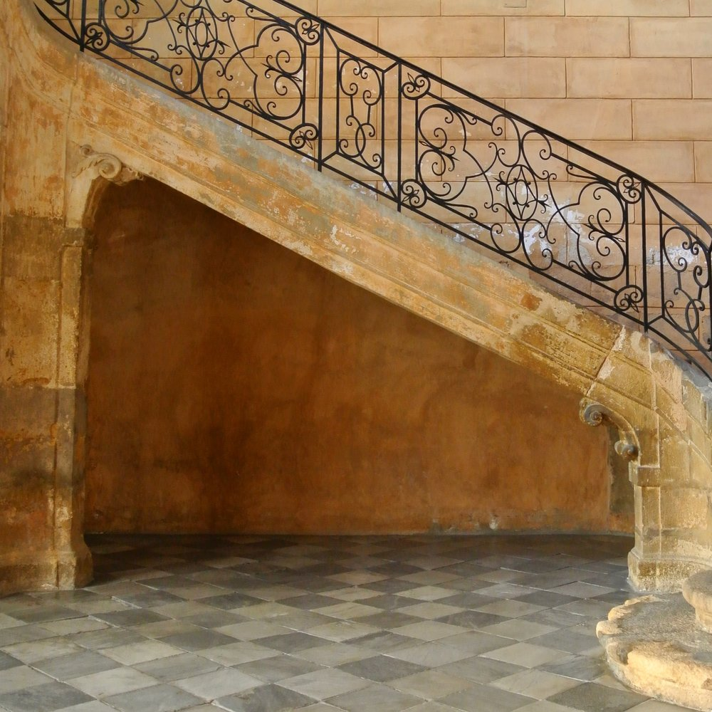 8. One of the splendid staircases with its elegant wrought-iron railing inside the 18th century Hotel d'Albertas mansion in Aix-en-Provence, France. Embellishments such as these were a sign of family wealth intended to call out the social status of the owner.
