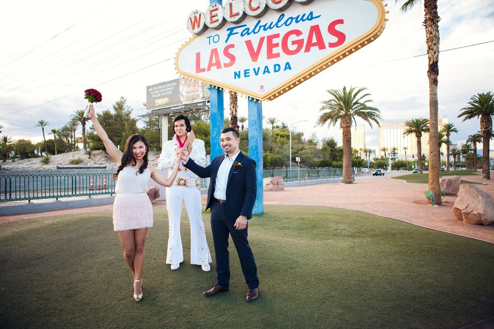 Herminia and Brandon renewed their vows for their five-year anniversary at the old Vegas sign, with Elvis presiding over the ceremony