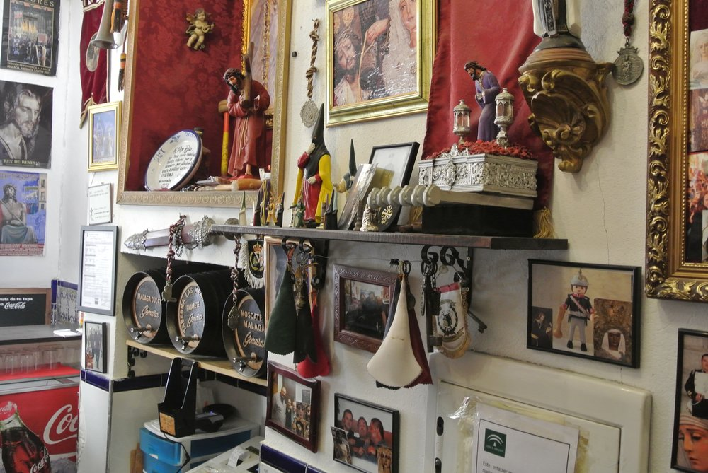 Relics pertaining to Santa Semana fill the walls at a bar in Málaga, Spain, owned by one of the Holy Week brotherhoods