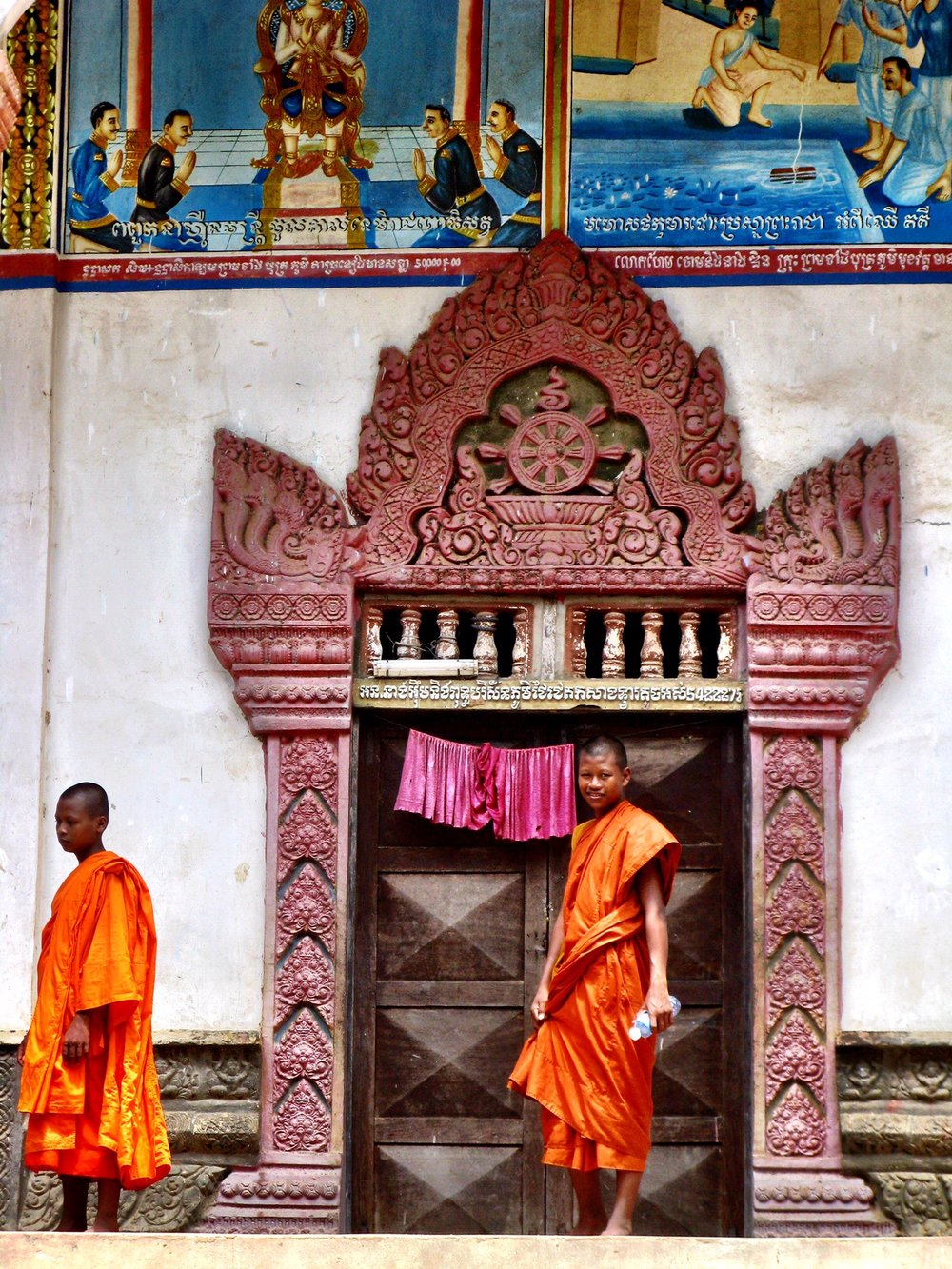 The telltale bright orange saffron-dyed robes of Buddhist monks is always a pleasant sight